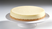 A Margararita in cheesecake form. Salty crust mimics the salt on a margarita glass. Cheesecake has tequila, Grand Marnier, lime & lemon flavors. Yum!