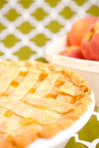 Summery peach cobbler made with pie crusts and pie crust strips instead of the usual biscuit topping.