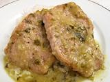 For a change of pace, try these delicious and succulent pork chops served with a green salsa topping.