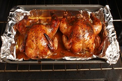 Baked Cornish game hens fresh out of the oven.
