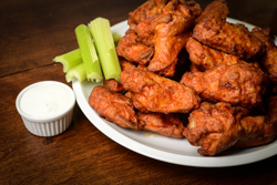 Chicken Buffalo Wings with Celery Sticks and Blue Cheese Dressing