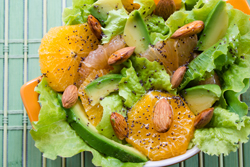 Avocado and Citrus make a refreshing salad for the springtime meal. Served with a slightly tart dressing and topped with slice almonds, this salad is a keeper.