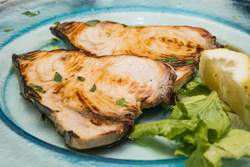 Swordfish is best when prepared in a simple way. This pan-seared swordfish, topped with a lemon-lime mixture, is both tasty and colorful and just a touch sweet.