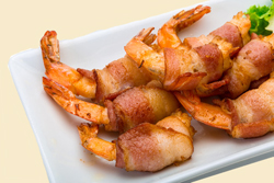 For an upscale treat at your next party, try these marinated bacon-wrapped shrimp. The Olive Wood Smoked Olive Oil and the Aged Balsamic make them pop!