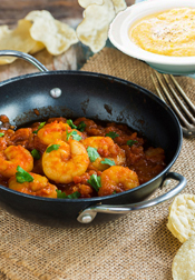 This spicy prawn dish served with cornmeal grits is to die for. Not difficult to make (the hardest part is assembling the spices), but worth the effort.