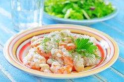 If you like risotto, you will love this dish. The creaminess of the risotto, mixed with Parmesan, and served with large shrimp makes for a special treat.