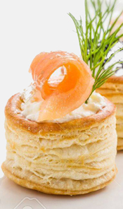 Vol au vent shells filled with whipped cream cheese and topped with a slice of smoked salmon make a unique and flavorful appetizer. Wonderful!
