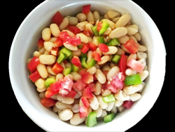 This is a very refreshing bean salad. The contrast between the soft beans and tomatoes and the crunchy red and green bell peppers is wonderful and pretty, too.