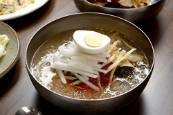 This scrumptious Korean Noodle Soup may seem daunting at first, but the results are well worth the effort. A delicious cold soup, this is a perfect hot-day soup.